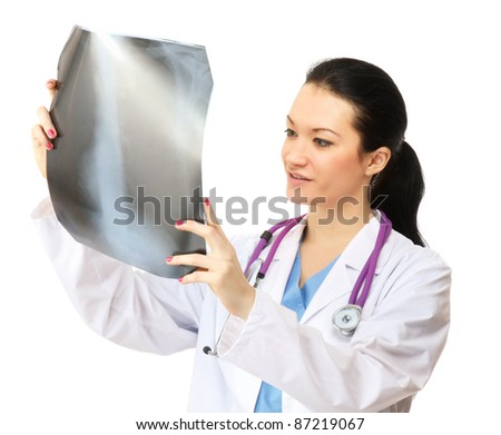 Doctor looking at x-ray isolated on white background - stock photo