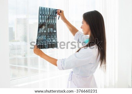 doctor looking at x-ray or MRI concept healthcare, medical and radiology concept. - stock photo