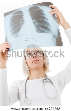 Doctor looking at x-ray picture - stock photo