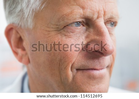 Doctor looking away in hospital room