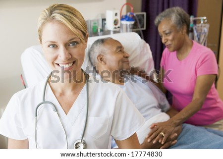 Doctor Looking Cheerful In Hospital Room - stock photo