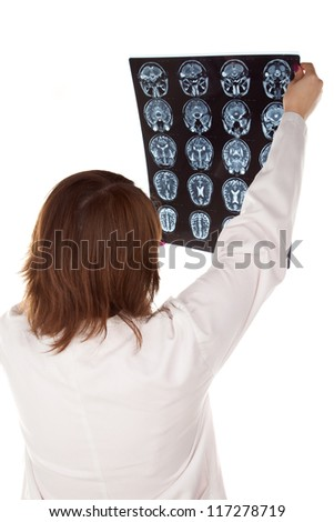 Doctor looking X-RAY of head isolated in white background.
