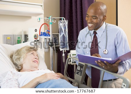 Doctor Making Notes About Patient - stock photo