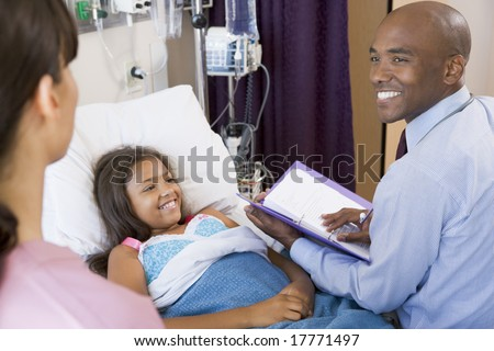 Doctor Making Notes On Young Girl - stock photo