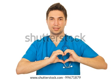 Doctor male showing heart shape isolated on white background - stock photo
