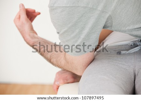 Doctor massaging the hip of his patient in a physio room