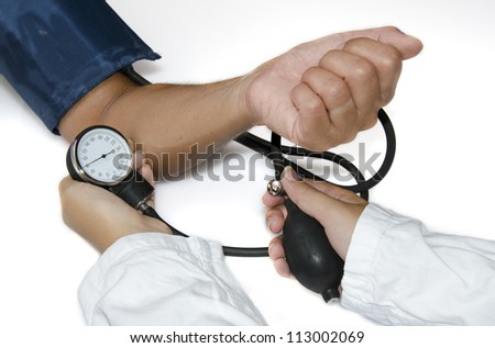 Doctor measuring blood pressure  on white background - stock photo
