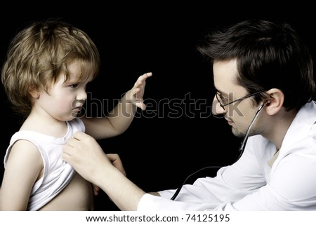 doctor measuring pulse to a child - stock photo