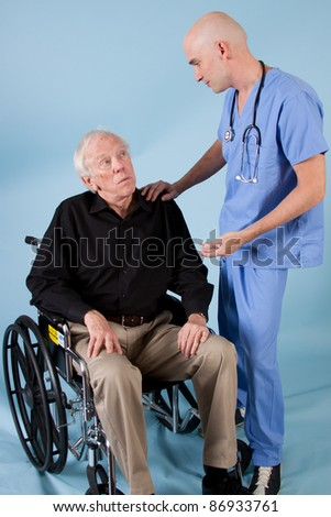 Doctor/medical professional talking to an elderly patient.