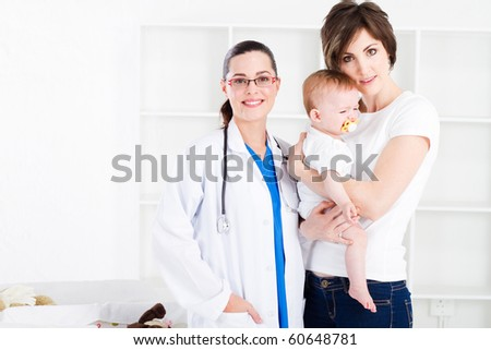 Doctor, mother and baby girl in doctor office - stock photo