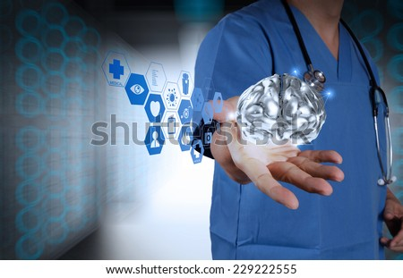 doctor neurologist hand show metal brain with green background as concept  - stock photo