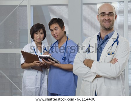 Doctor,Nurse and Intern standing with white background - stock photo
