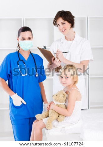 doctor, nurse and little patient - stock photo
