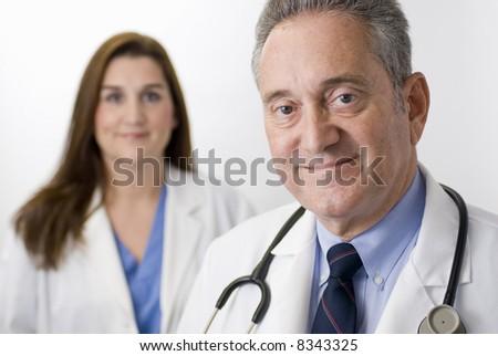 Doctor nurse health care professional white background - stock photo