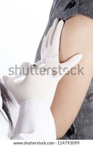Doctor / Nurse holding a syringe give an injection, on white background - stock photo