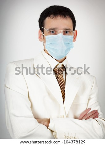 Doctor of Medicine with glasses and a mask - stock photo