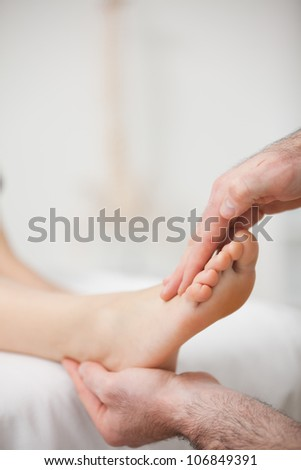 Doctor offering a foot massage in a medical room