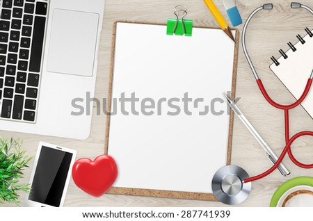 doctor office desk top view with blank clipboard - stock photo