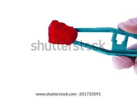 Doctor or Nurse Hand with Medical Gloves Holding Tweezers and Cotton Ball with Blood for concept and idea of Surgery First-Aid care for patients Medical Tool and Surgery Instrument, Isolated on white. - stock photo