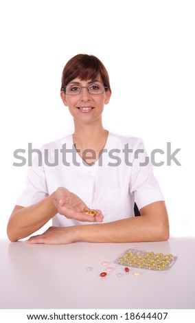 Doctor or nurse having a lot of pill - stock photo