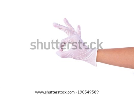 """Doctor or Nurse human hand showing gesture """"OK"""" Okay sign for Good Great Confirm for protection and care for patients with Medical Rubber Clean Glove isolated on white background. - stock photo"""