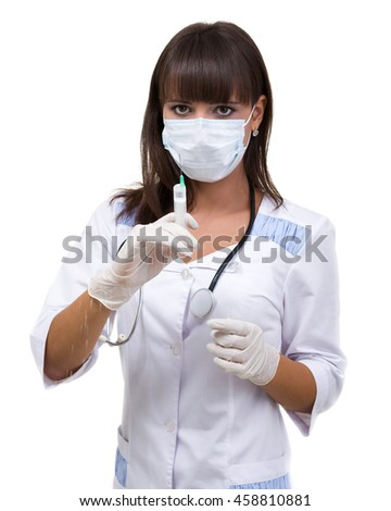 Doctor or nurse in face mask and lab coat holding syringe. Isolated over white. - stock photo