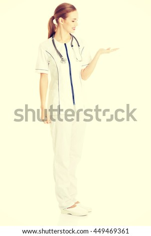 Doctor or nurse is presenting a copy space - stock photo