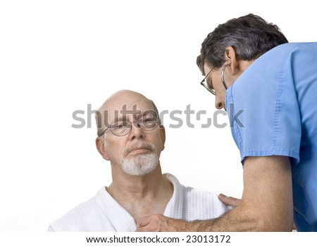 Doctor or nurse listening to senior man's heart with stethoscope - stock photo