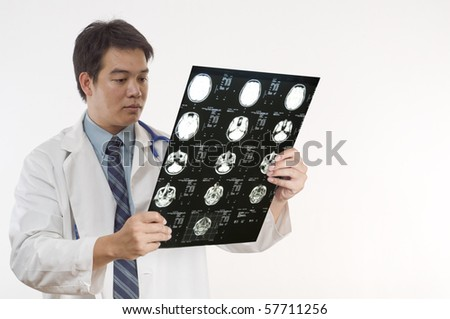 Doctor or Nurse looking at patients MRI - stock photo
