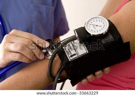 Doctor or nurse taking a patient's blood pressure