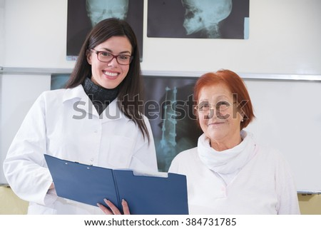 doctor or nurse talking to patient in hospital - stock photo