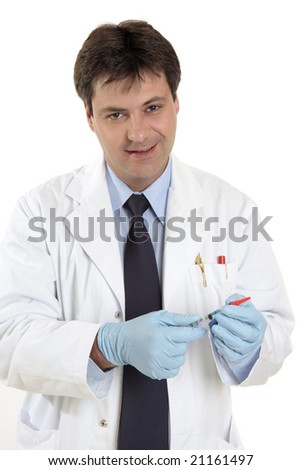 Doctor or physician with a dose of medicine or vaccine in a siringe with protective cover.