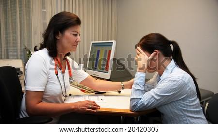 Doctor patient in conversation - stock photo