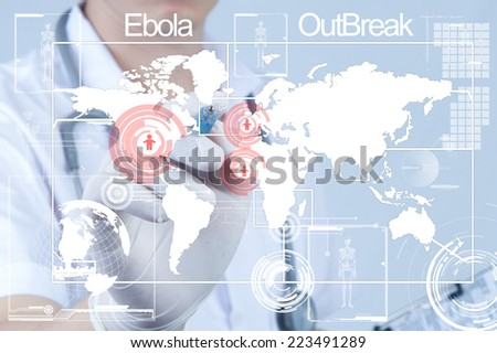 Doctor pointing pen to ward screen about ebola out brake - stock photo