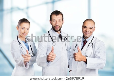 Doctor. Portrait of happy doctors standing in a row - stock photo