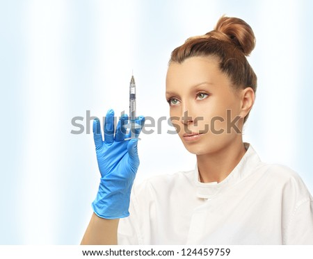 Doctor prepare to Injection of beauty products - stock photo