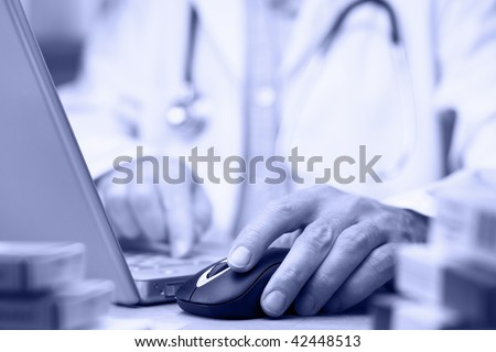 Doctor preparing online internet medical record blue tone - stock photo