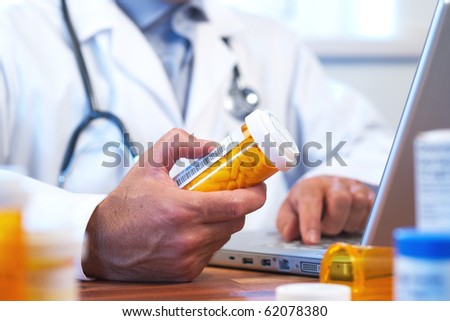 Doctor preparing online internet prescription selective focus - stock photo