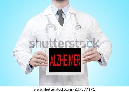 doctor presenting diagnosis alzheimer word in digital tablet screen concept for medical  - stock photo