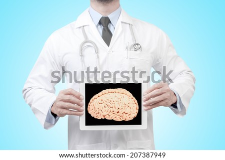 doctor presenting diagnosis brain in digital tablet screen concept for medical for creative thinking - stock photo