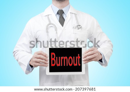 doctor presenting diagnosis burnout word in digital tablet screen concept for medical  - stock photo