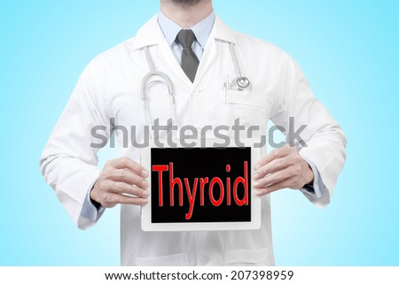doctor presenting diagnosis thyroid word in digital tablet screen concept for medical  - stock photo