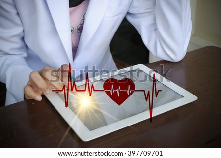 Doctor pressing tablet with  E-Health concept , business concept