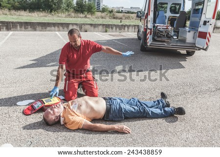 Doctor Providing First Aid with a Defibrillator