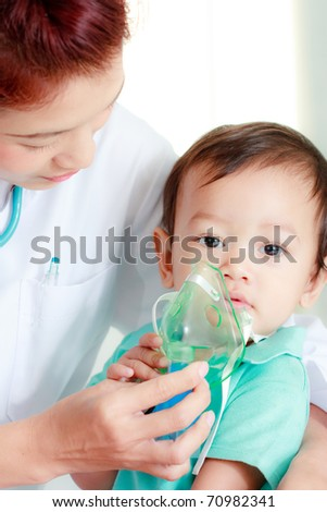 Doctor putting medical mask on baby's face