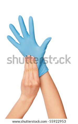 doctor putting on blue sterilized medical glove for making operation - stock photo