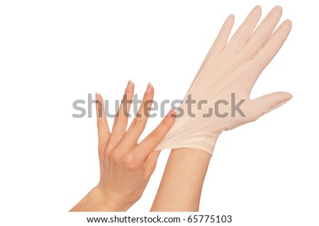 Doctor putting on sterilized medical glove for making operation - stock photo