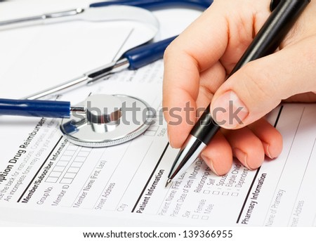 Doctor ready to fill patient information in Prescription form - stock photo
