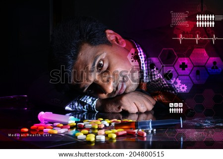 doctor rest with his head on heap of pills   - stock photo