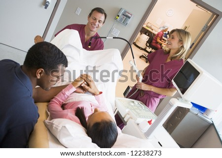 Doctor retrieving eggs using vaginal ultrasound - stock photo